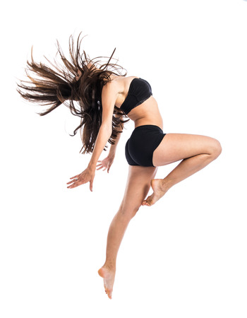 Young fitness female jumping
