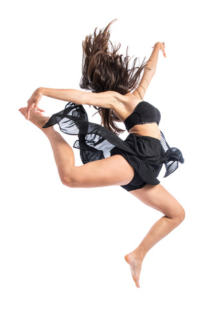 Young ballet dancer jumping over white background photo