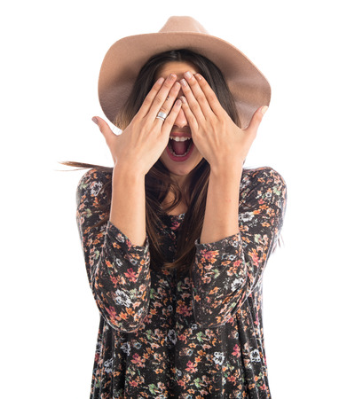 Woman covering her eyes photo