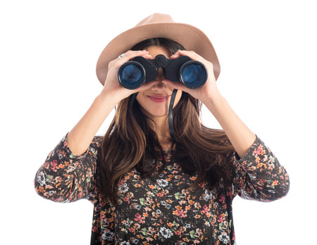 Woman with binoculars 스톡 콘텐츠