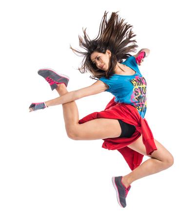 baile: Adolescente niña saltando en el estilo de baile callejero
