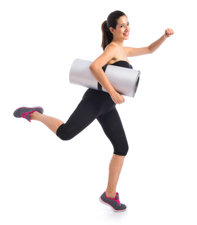 Young woman holding a pilates mat photo