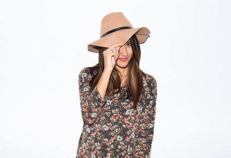 Cute woman with hat in studio photo