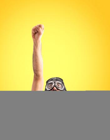 gente loca: Superhero haciendo el gesto de la mosca Foto de archivo