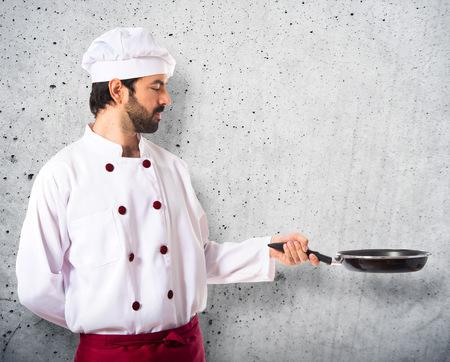 frying: Chef holding frying pan