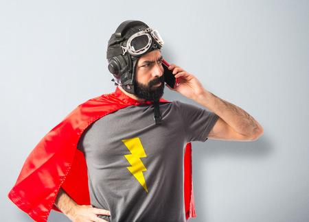 Superhero talking to mobile photo