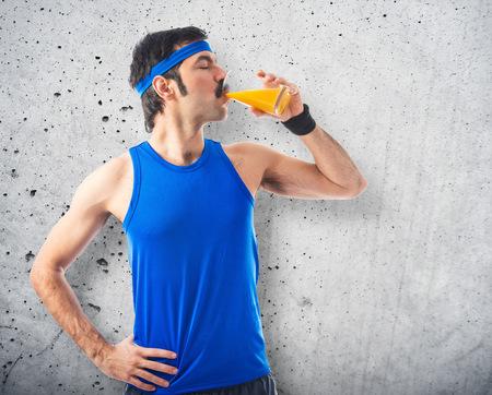 sportman: Vintage sportman drinking orange juice