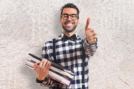preppy: Happy posh boy holding books Stock Photo