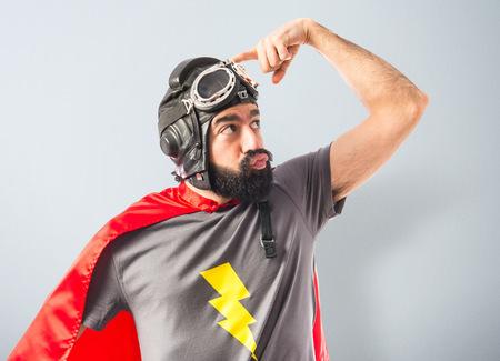 Superhero thinking over white background photo
