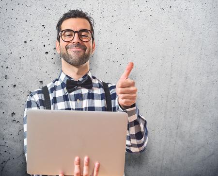 posh: Posh boy with laptop over white background