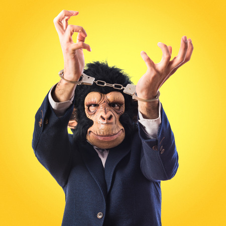 Monkey man with handcuffs photo