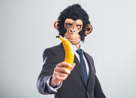 Monkey man holding a banana photo