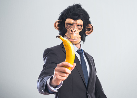 Monkey man holding a banana photo