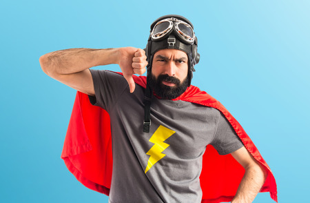 disapprove: Superhero doing bad signal Stock Photo