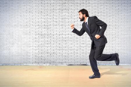businessman running: Businessman running fast over white background