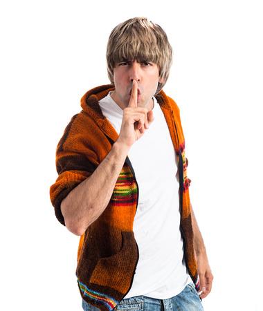 silence gesture: Blonde man making silence gesture