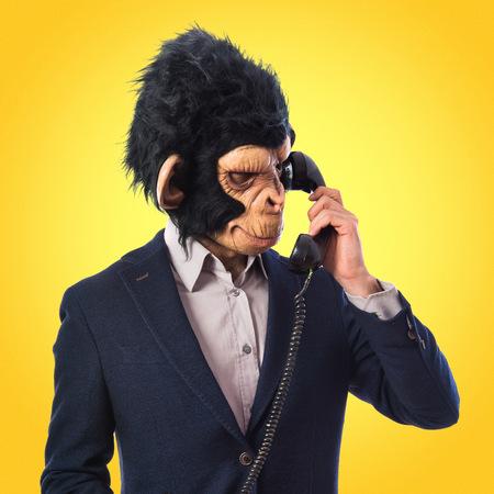 Monkey man talking to vintage phone photo