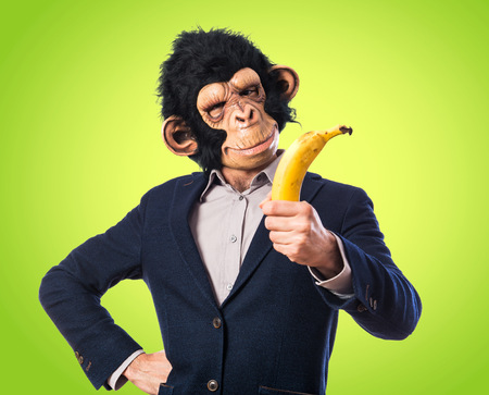 funny costume: Monkey man holding a banana