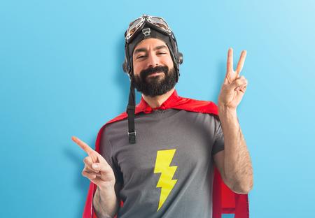 Superhero doing victory gesture photo