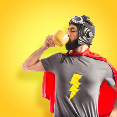 Super hero holding a cup of coffee Stock Photo