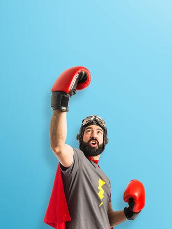 Lucky super hero over white background photo