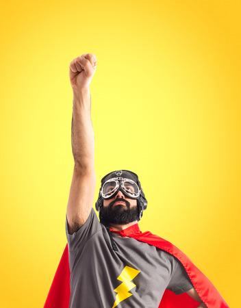 geek: Superhero haciendo el gesto de la mosca Foto de archivo