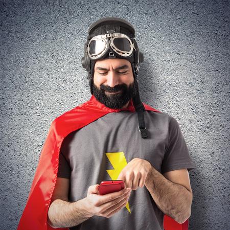 Superhero writting a sms photo