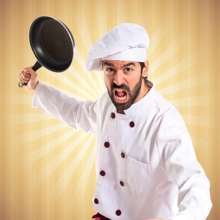 frying pan: Chef holding frying pan