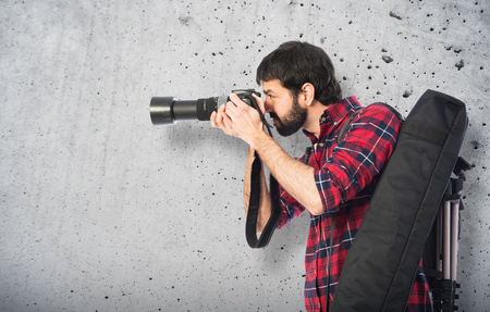 photography background: Photographer taking a photo