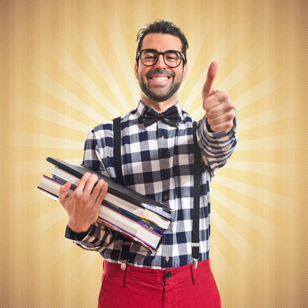 Happy posh boy holding books Stock Photo