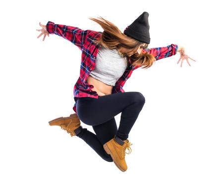 ヒップホップ スタイルでジャンプの女の子
