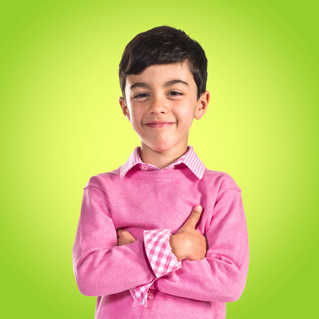 preppy: Brunette kid with his arms crossed