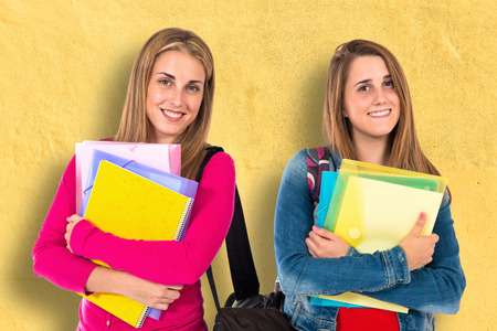 a study: Student women over isolated white background Stock Photo