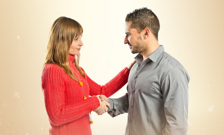 agreeing: Couple making a deal over isolated white background Stock Photo