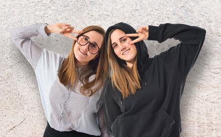 preppy: Happy twin sisters Stock Photo