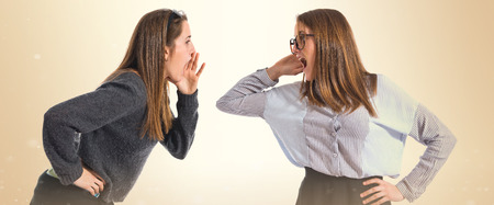 One girl shouting and other listening Stock Photo