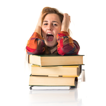 frustrated student: frustrated student over white background Stock Photo