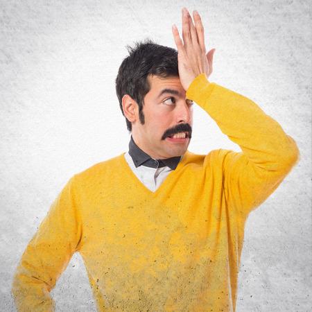 doubts: Man with moustache having doubts