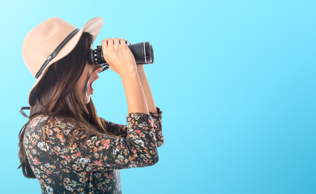 Surprised woman with binoculars Stock Photo