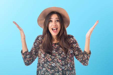 Happy woman doing surprise gesture Standard-Bild