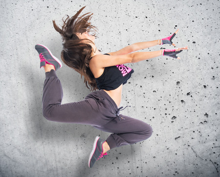 hip hop girl: Teenager girl jumping in hip hop style Stock Photo
