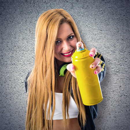 spray can: girl with a spray can Stock Photo