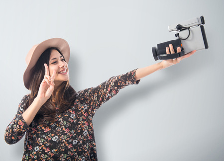 Woman with vintage video camera