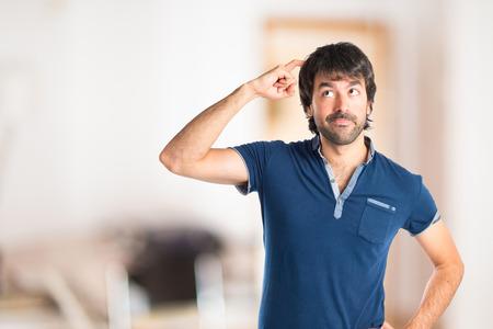 Man thinking over isolated white background