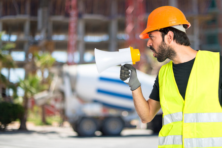 loudspeaker: Workman shouting over isolated white background
