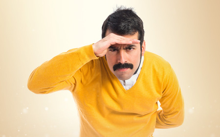 white moustache: Man with moustache showing something Stock Photo