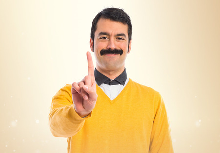 Man with moustache counting one