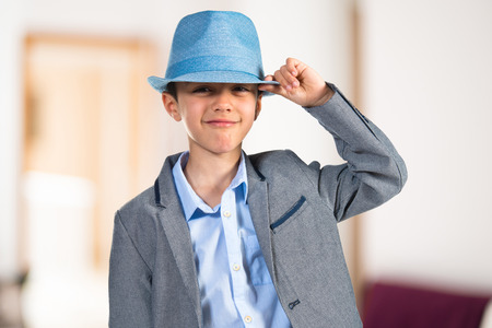7 year old boys: Happy child with blue hat