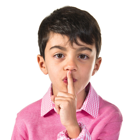 preppy: Boy making silence gesture