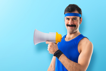 geek: Sportman shouting by megaphone